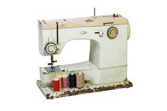 Old Rusty Sewing Machine with Colored Cottons Stock Photos