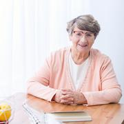 Old woman with health afflictions - stock photo