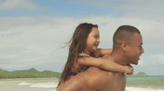 Father giving piggyback ride his little daughter Stock Footage