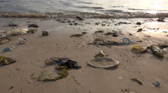 4k Human made pollution and plastic trash at Indonesia beach Stock Footage