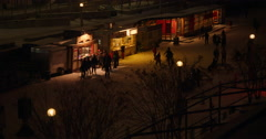 People Skating and Buying Beavertails on the Rideau Canal at Night Stock Footage