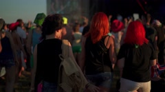 Girls with hands up dancing, singing and listening the music during concert show - stock footage