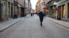 Tourists walking on Stockholm street. Handheld shot, camera moves from street to Stock Footage