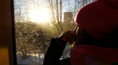 Thoughtfulin woman riding public bus in a winter day. Close up of face at the Stock Footage