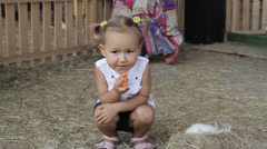 Cute little girl eat carrot with rabbits Stock Footage