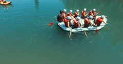 People riding a rafting boat on the Grande Nive River Stock Footage