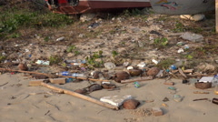 4k Human made pollution and plastic trash at dirty beach Stock Footage