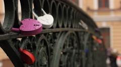 love symbol padlocks chained on bridge - stock footage