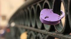 Love symbol padlock chained on bridge Stock Footage