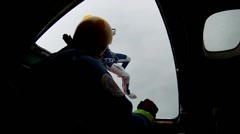 Skydivers jump form airplane in clouds. Extreme. Height. Falling. Adrenaline - stock footage