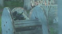Girl sitting in ambush on paintball - stock footage