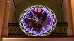 Luminous clock at night Stock Footage