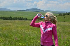 Woman in Sport Ware Drinking Water Stock Photos