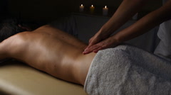Man relaxing with massage at beauty spa Stock Footage