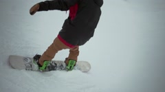 Snowboarder ride at slope in snowy mountain. Jump from trampoline, but fail. Ski - stock footage