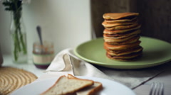Fried eggs with bread toasts and pancake stack. Cooked eggs, roasted bread slice Stock Footage