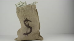 Sack of Money - Cash Bag - Burlap sack full of american dollars Stock Footage