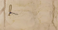 Man writing the word humanity in the sand Stock Footage