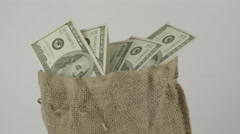 Dolly shot of Sack of Money - Cash Bag - Burlap sack full of american dollars Stock Footage
