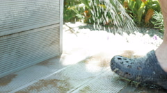 A person at the washing station to wash their feet - stock footage