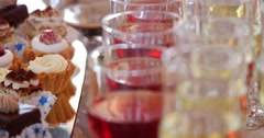 Close up photo with drings and candys on festive table Stock Footage