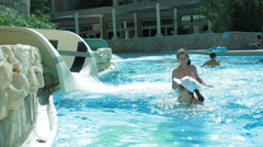 Most kids love the waterpark and waterslides Stock Footage