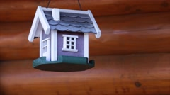 Colorful bird house on grunge background Stock Footage