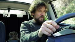 Angry stressed out man screaming in car slow motion Stock Footage