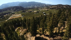 Farming Aerials: Reveal Of Several Orchards From Mountain Side Stock Footage