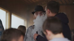 Adult men smoke electronic cigarette on street. Vaper festival. Steam. People - stock footage