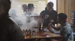 Men smoke electronic cigarette in specialized store on street. Vaper festival - stock footage