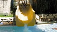 A grown woman is on waterslide in aqua park Stock Footage