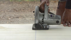 Construction worker cutting wood planks . Stock Footage