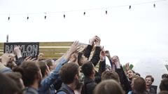 People catch objects from stage. Event. Festival at seafront. Audience Stock Footage