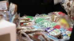 People buying delicious ginger cookies, traditional baked Christmas souvenirs Stock Footage