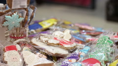 Sale of delicious Christmas cookies at charity trade fair, fundraising event Stock Footage