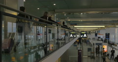 Airport hall with passengers shot from back Stock Footage