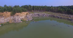 Flooded stone quarry in the woods of Eastern Europe Stock Footage