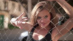 Sexy woman behind the wire - stock footage