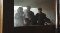 Men smoke electronic cigarette in specialized shop at street. Vaper festival - stock footage