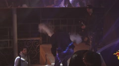 Two boys exhale steam from electronic cigarette in nightclub. Cameraman. Vaper - stock footage