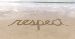 Aerial of the word Respect in the sand Stock Footage