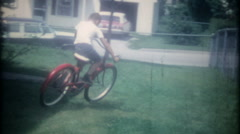 3496 a young boy falls off a bicycle time after time-vintage film home movie - stock footage