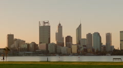 People Walking And Running Along The South Perth Foreshore - stock footage
