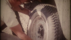3500 dad changes a flat tire on the old truck-vintage film home movie Stock Footage