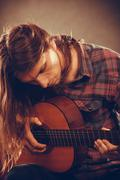 Guitarist is playing the guitar. - stock photo