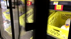 Woman buying Dairyland chocolate milk beverage inside Walmart store Stock Footage