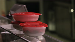 Three takeaway containers taken by a woman from a glass table in a restaurant Stock Footage
