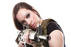 Army Woman With Gun - Beautiful woman with rifle plastic Stock Photos