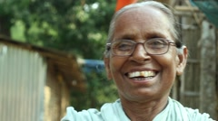 Happy elderly lady speaks and laughs in a village in Bengal, India Stock Footage